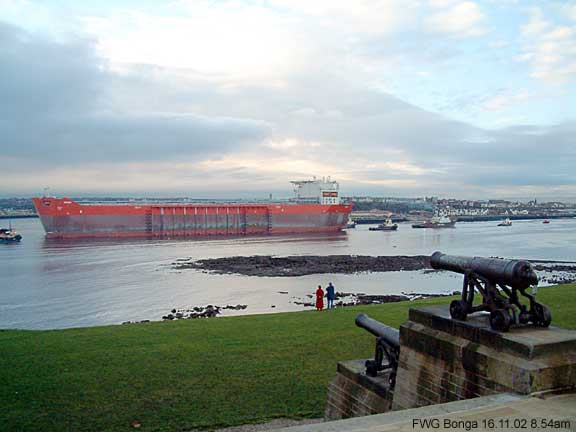 With the cannons approval. The immense oil and gas production platform Bonga, is towed towards the AMEC yard, Wallsend.